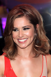 Cheryl Cole was all smiles as she showed off her side swept layered cut.