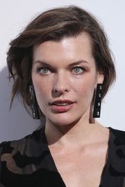 Milla Jovovich attended the De Grisogono party wearing her hair in a mildly messy bob.