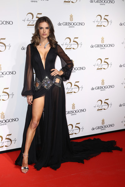 Alessandra Ambrosio was a glamorous head-turner in a flowing black Roberto Cavalli Couture gown with a plunging neckline, crystal-bordered cutouts, and a thigh-high slit at the De Grisogono party during Cannes.