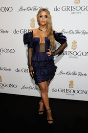 Rita Ora worked her cleavage in a blue and black Ulyana Segeenko Couture off-the-shoulder dress at the De Grisogono Love on the Rocks party.