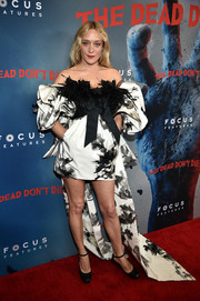 Chloe Sevigny stole the spotlight in a Marc Jacobs off-the-shoulder dress with puffed sleeves, a feathered bodice, and a flowing train at the New York premiere of 'The Dead Don't Die.'