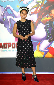 Zazie Beetz looked playfully glam in a mirror-embellished LBD by Miu Miu at the 'Deadpool 2' photocall in London.