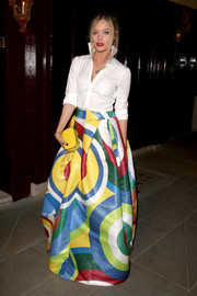 A classic white button-up with a popped collar balanced out Laura Whitmore's voluminous, floor-length skirt.