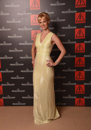 January Jones kept it classy and ladylike at the Venice Film Festival in a beaded yellow gown by BOSS.