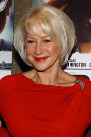 "Helen Mirren arrived glowing to the ""The Debt"" screening. Her shiny, cool blond, slightly layered bob is ageless."