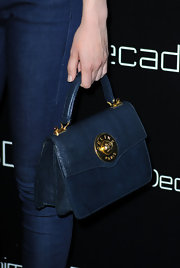 Gillian Jacobs showed off the fall seasons box bag trend with a classic navy tote.