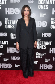 Priyanka Chopra softened her masculine jacket with a pair of fringed wide-leg pants, also by Brunello Cucinelli.