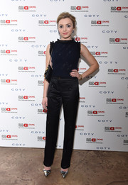 Peyton List attended the Delete Blood Cancer dinner wearing a sleeveless navy knit top with ruffle detailing.
