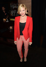 Brittany played with bold colors when she paired this red blazer with white and red checked pants.