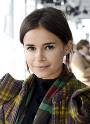 Miroslava Duma pulled her hair back into a casual chignon for the Delpozo fashion show.