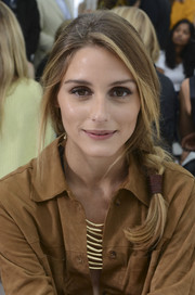 Olivia Palermo looked darling wearing her hair in a loose side braid at the Delpozo fashion show.