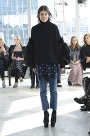 Leandra Medine showed off her unique style with this fur-embellished black turtleneck during the Delpozo fashion show.