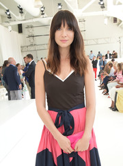 Caitriona Balfe paired a hot-pink leather clutch with a color-block dress, both by Delpozo, for the brand's fashion show.