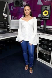 Demi Lovato stayed on trend in a bell-sleeve, off-the-shoulder shirt by Caroline Constas while visiting KISS FM.