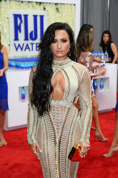 Demi Lovato Box Clutch [red carpet,clothing,carpet,flooring,fashion,long hair,dress,abdomen,shoulder,trunk,fiji water,demi lovato,annual grammy awards,staples center,los angeles,california,the 59th annual grammy awards]