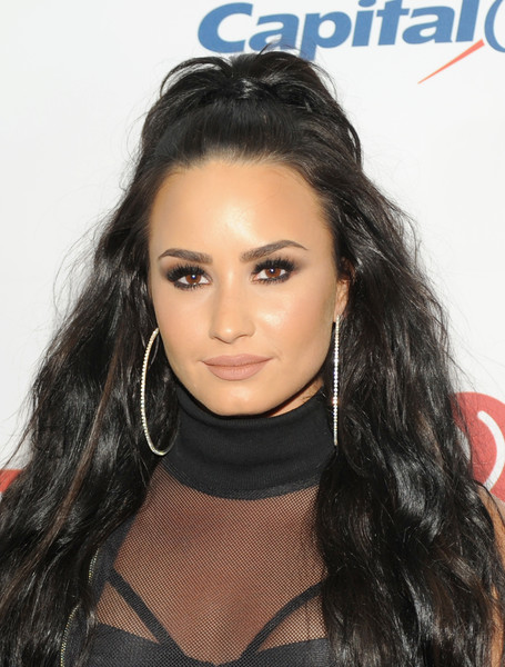 Demi Lovato Diamond Hoops [hair,face,hairstyle,eyebrow,black hair,lip,forehead,long hair,beauty,chin,room,rosemont,illinois,allstate arena,jingle ball 2017,kiss fm,demi lovato]