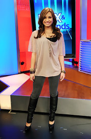 Demi Lovato showed off her casual side while hitting the Fox and Friends studios. She paired her look with a cool double point cuff bracelet.