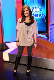 The actress rocked an oversized tee with skinny jeans and cutout knee high boots.