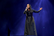 Demi Lovato went goth in a black duster for a performance.