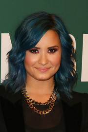 Demi Lovato finished off her edgy look with a gold chain necklace by Luv Aj.