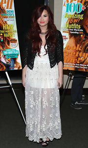 Demi Lovato wore a sheer white maxi-dress with a black lace cardi for the 'Seventeen' magazine cover issue celebration.