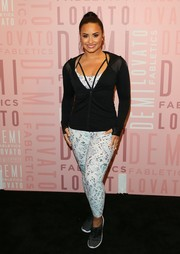 Demi Lovato visited a Fabletics store wearing a pair of printed leggings and a matching sports bra.