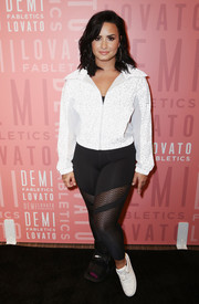 Demi Lovato teamed her jacket with black sheer-panel leggings by Fabletics.