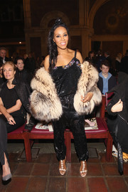 June Ambrose donned a slouchy black sequin jumpsuit for the Dennis Basso fashion show.