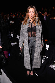 Katie Cassidy was equal parts smart and sexy at the Dennis Basso fashion show in a French Connection tweed coat layered over a sheer lace blouse.