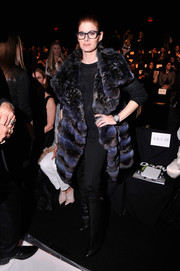 Debra Messing glammed it up in a two-tone fur coat during the Dennis Basso fashion show.