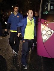 Andres Iniesta wears a yellow Nike polo top, while traveling with his team.