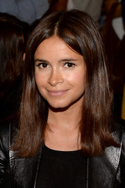Miroslava Duma wore a hippie-chic center-parted hairstyle at the Derek Lam fashion show.
