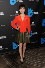 Sami Gayle brought a bright pop of color to the Design by Hand cocktail party with this scarlet silk blouse.