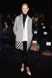 Karolina Kurkova donned a fun-looking mixed-print wool coat for the Desigual fashion show.