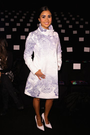 Catherine Giudici bundled up in style in a white and purple funnel-neck coat for the Desigual fashion show.
