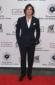 Nacho Figueras wore a stylish navy double-breasted suit to the 2012 Destination Fashion benefit.