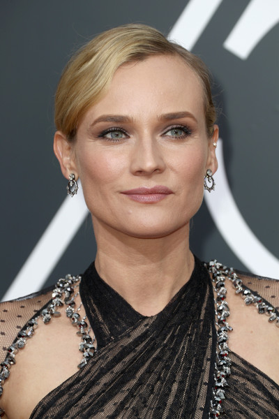 Diane Kruger Classic Bun [hair,face,hairstyle,eyebrow,blond,fashion model,beauty,shoulder,chin,lip,arrivals,diane kruger,the beverly hilton hotel,beverly hills,california,golden globe awards,annual golden globe awards]