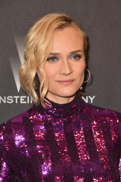 Diane Kruger Messy Updo [hair,human hair color,blond,beauty,hairstyle,fashion model,purple,eyebrow,chin,shoulder,fiji water,grey goose vodka,diane kruger,golden globes,the beverly hilton hotel,weinstein company,netflix,party,netflix golden globe party,arrivals]