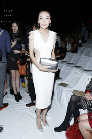 Lily Kwong looked fashionably sexy in a white cutout dress at the Diane Von Furstenberg show.