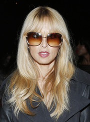 Rachel Zoe sported feathered waves and wispy bangs when she attended the Diane Von Furstenberg fashion show.