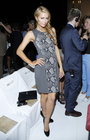 Paris Hilton showed her classier side in a gray snakeskin-print sheath during the Diane Von Furstenberg fashion show.