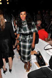 June Ambrose paired yellow T-strap platform sandals with her plaid shirtdress for a pop of color at the Diane Von Furstenberg fashion show.