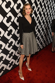 Allison Williams was '50s-chic in a black-and-white fit-and-flare wrap dress by Diane von Furstenberg during the Journey of a Dress exhibition opening.