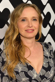 Julie Delpy wore her long wavy locks down during the Journey of a Dress exhibition opening.