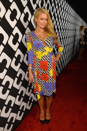 Paris Hilton looked very DVF in this floral wrap dress during the Journey of a Dress exhibition opening.