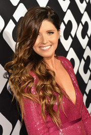 Katherine Schwarzenegger looked ultra girly with her long stream of curls during the Journey of a Dress exhibition opening.
