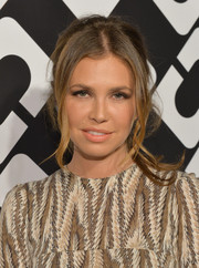 Dasha Zhukova wore her hair in a retro-chic ponytail during the Journey of a Dress exhibition opening.