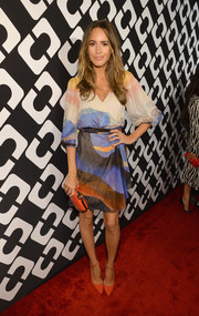 Louise Roe went all out with the colors, teaming her print dress with coral ankle-strap pumps.