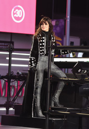 Camila Cabello finished off her outfit with silver thigh-high boots that were an exact match to her trousers.