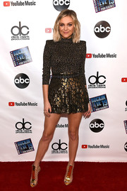 Kelsea Ballerini lengthened her legs with a pair of gold gladiator heels.